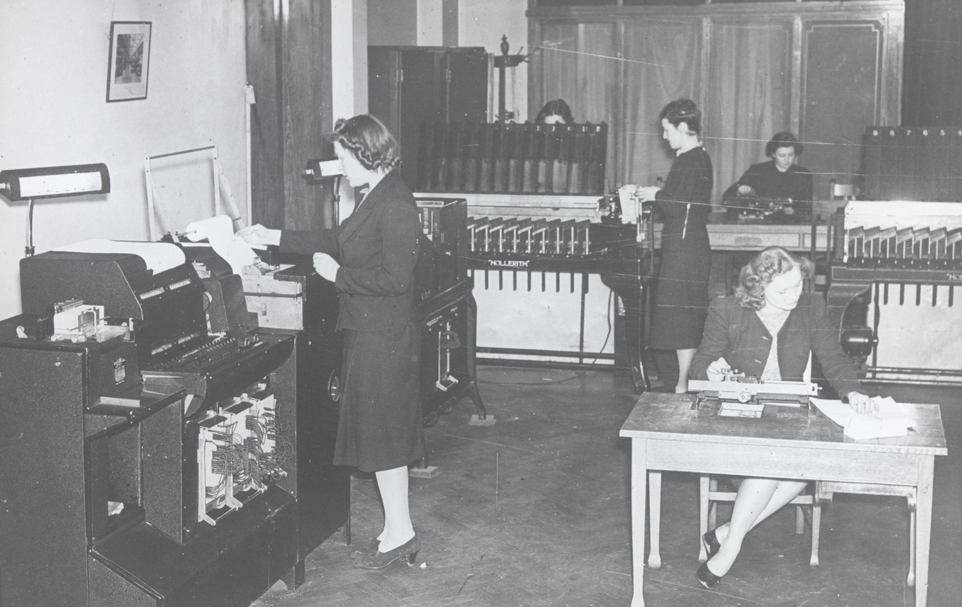 Red Cross workers calculating POW capture cards using a Hollerith Machine, one of six owned by the ICRC