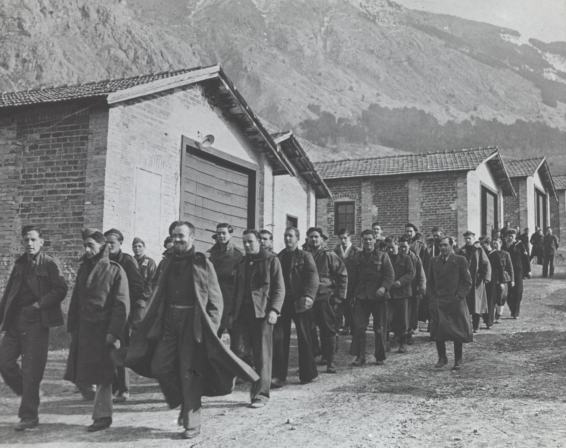 Unidentified prisoners of war camp: men walking in formation