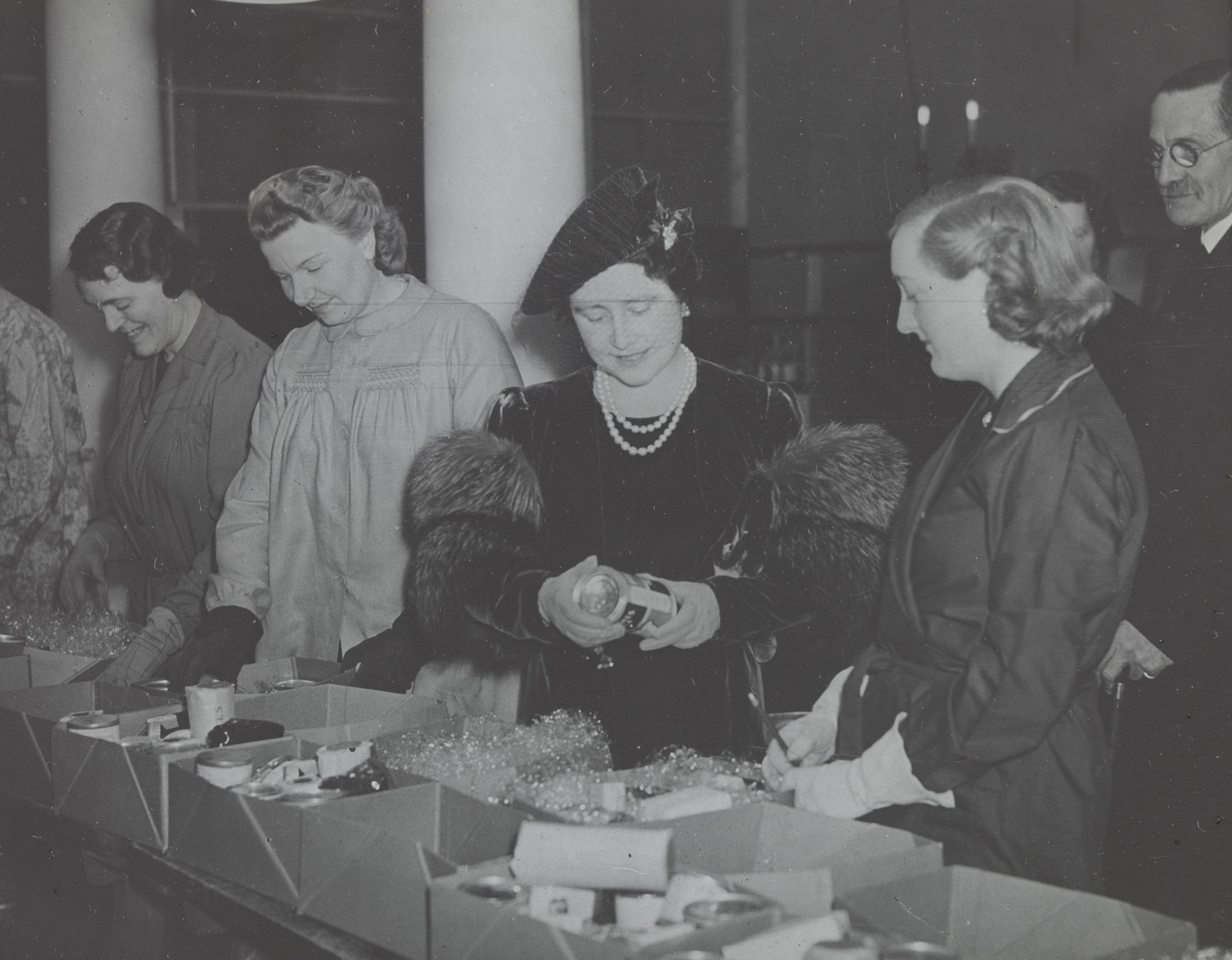 H.M. Queen Elizabeth I (1900-2002) president of British Red Cross visits a Red Cross care package centre