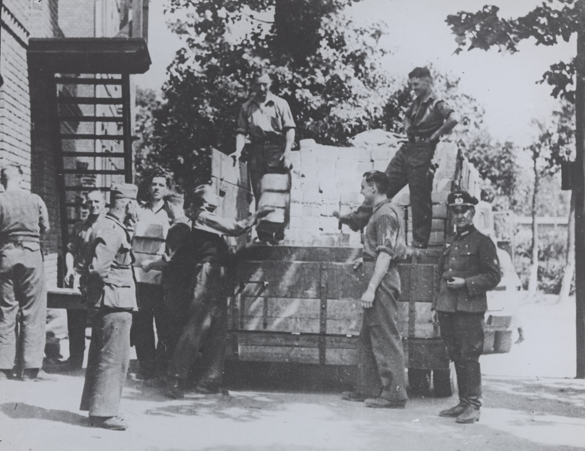 Prisoners of war camp: Stalag XX A. English Red Cross parcels being received and unloaded.Thorn, Germany